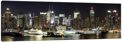 Buildings in a city lit up at night, Hudson River, Midtown Manhattan, Manhattan, New York City, New York State, USA Canvas Art Print