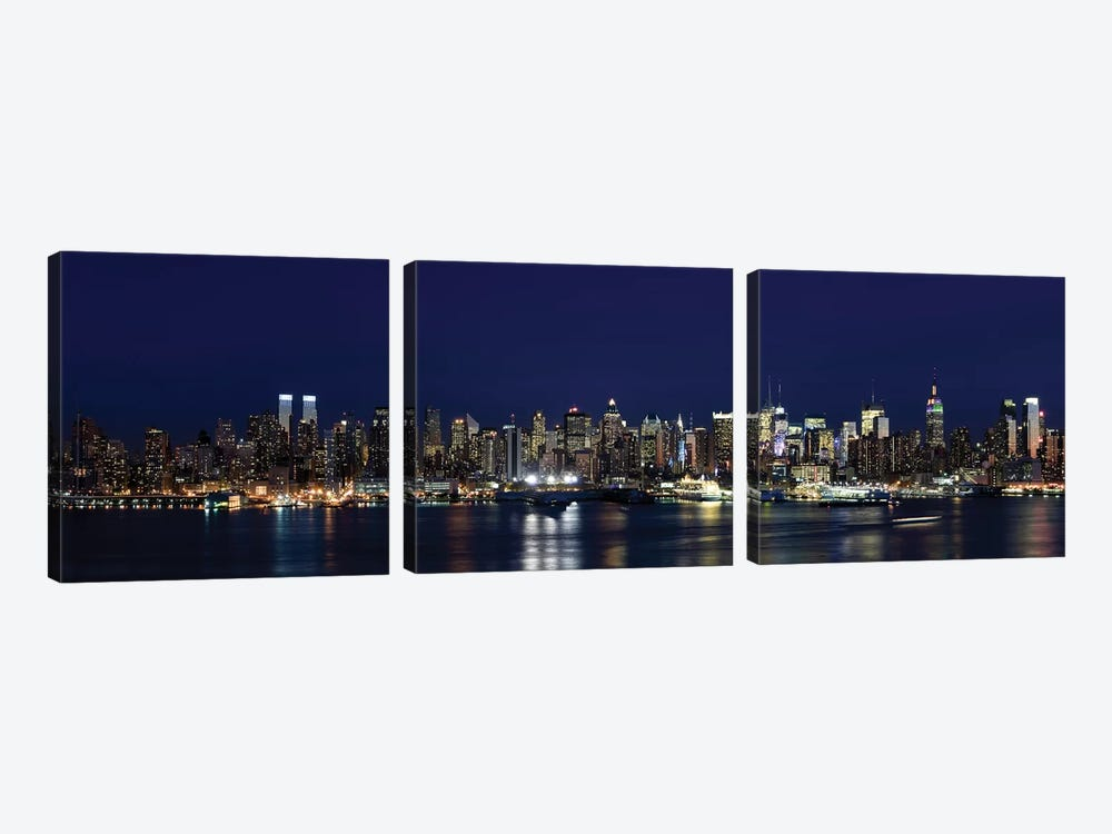 Buildings in a city lit up at dusk, Hudson River, Midtown Manhattan, Manhattan, New York City, New York State, USA by Panoramic Images 3-piece Canvas Art Print