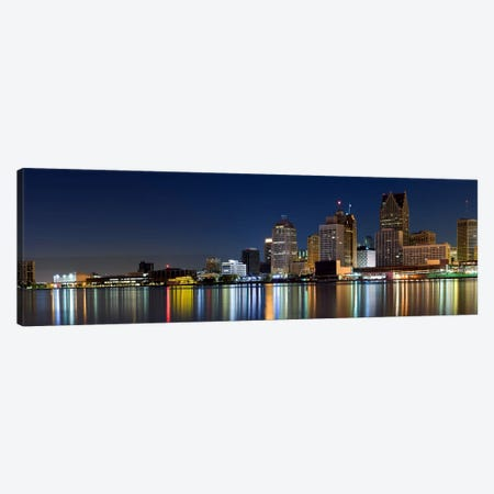 Buildings in a city lit up at dusk, Detroit River, Detroit, Michigan, USA Canvas Print #PIM8026} by Panoramic Images Canvas Artwork