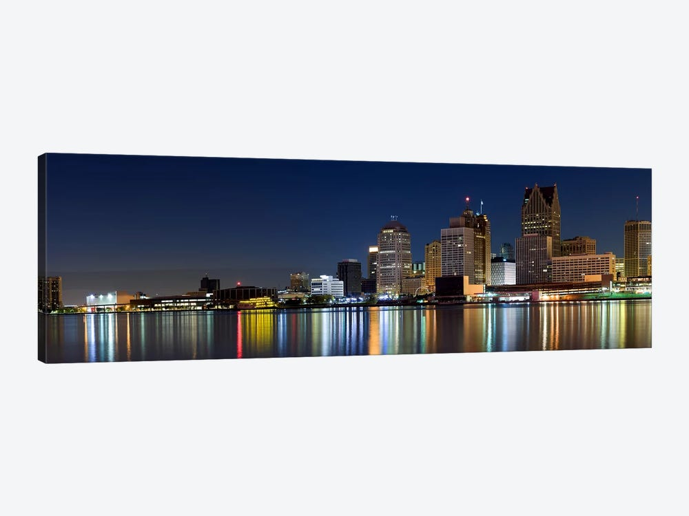 Buildings in a city lit up at dusk, Detroit River, Detroit, Michigan, USA by Panoramic Images 1-piece Canvas Art Print