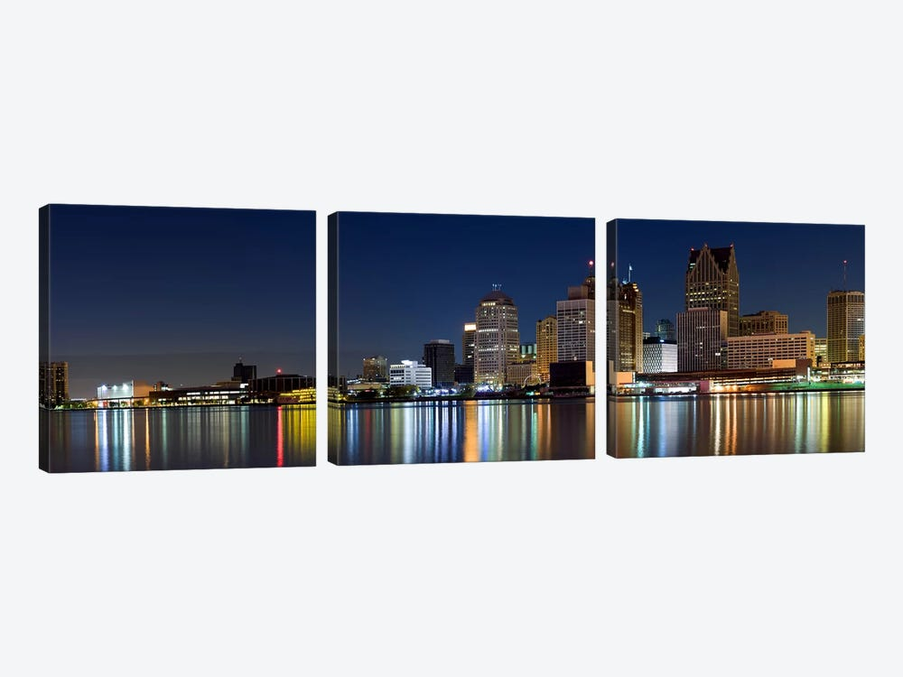 Buildings in a city lit up at dusk, Detroit River, Detroit, Michigan, USA by Panoramic Images 3-piece Canvas Print