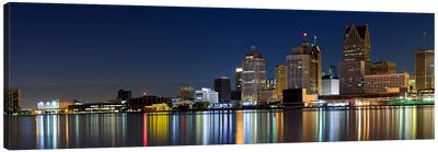 Buildings in a city lit up at dusk, Detroit River, Detroit, Michigan, USA Canvas Art Print