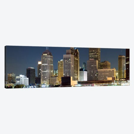 Buildings in a city lit up at night, Detroit River, Detroit, Michigan, USA Canvas Print #PIM8027} by Panoramic Images Canvas Artwork