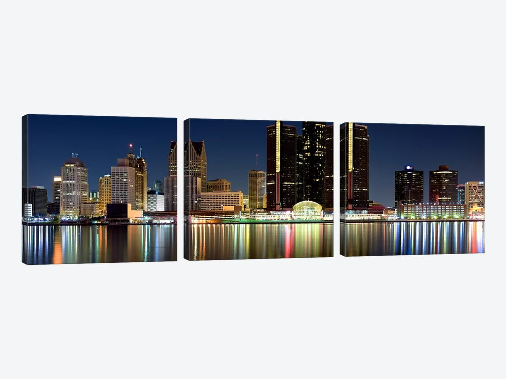 Buildings in a city lit up at night, Detroit River, Detroit, Michigan, USA #2 by Panoramic Images 3-piece Art Print
