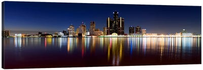 Buildings in a city lit up at duskDetroit River, Detroit, Michigan, USA Canvas Art Print