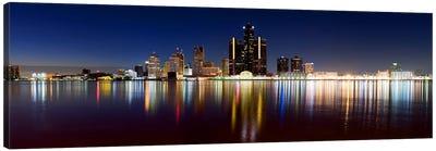 Buildings in a city lit up at duskDetroit River, Detroit, Michigan, USA Canvas Art Print