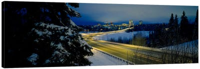 Winding road running through a snow covered landscape, Anchorage, Alaska, USA Canvas Art Print