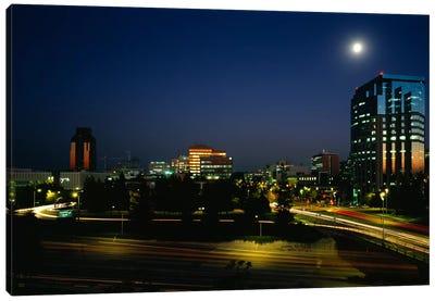 Buildings lit up at night, Sacramento, California, USA Canvas Print #PIM804