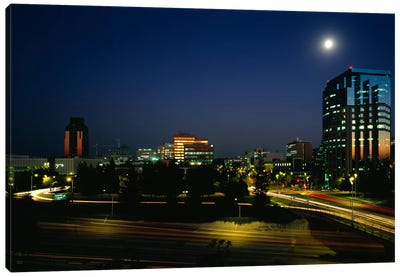 Buildings lit up at night, Sacramento, California, USA Canvas Art Print