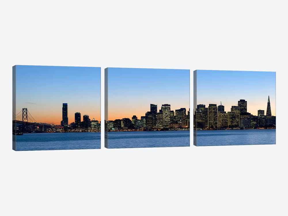 City skyline and a bridge at dusk, Bay Bridge, San Francisco, California, USA 2010 by Panoramic Images 3-piece Canvas Art Print