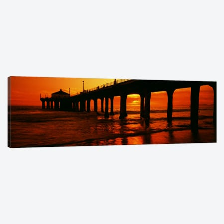 Silhouette of a pier at sunset, Manhattan Beach Pier, Manhattan Beach, Los Angeles County, California, USA Canvas Print #PIM8183} by Panoramic Images Canvas Artwork