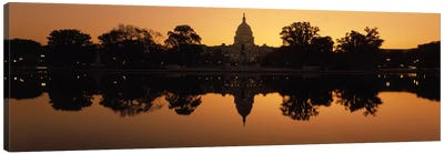 Reflection of a government building in water at duskCapitol Building, Washington DC, USA Canvas Print #PIM8212