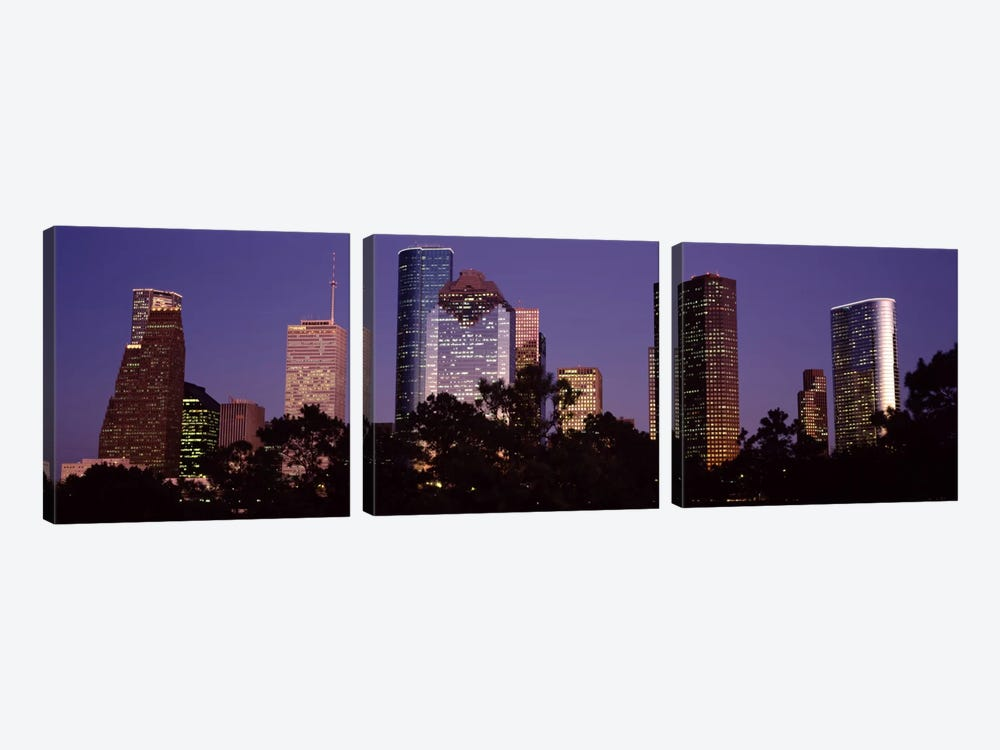 Buildings in a city lit up at duskHouston, Harris county, Texas, USA by Panoramic Images 3-piece Art Print