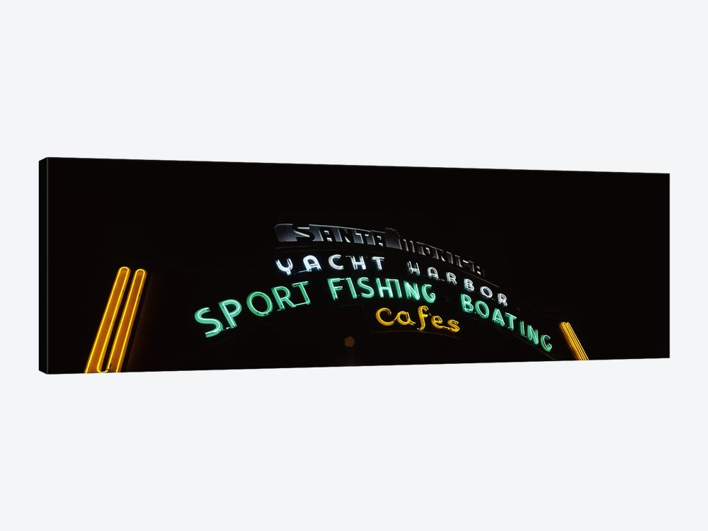Low angle view of a neon signboard, Santa Monica Pier, Santa Monica, Los Angeles County, California, USA by Panoramic Images 1-piece Art Print