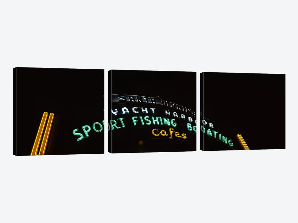 Low angle view of a neon signboard, Santa Monica Pier, Santa Monica, Los Angeles County, California, USA by Panoramic Images 3-piece Art Print