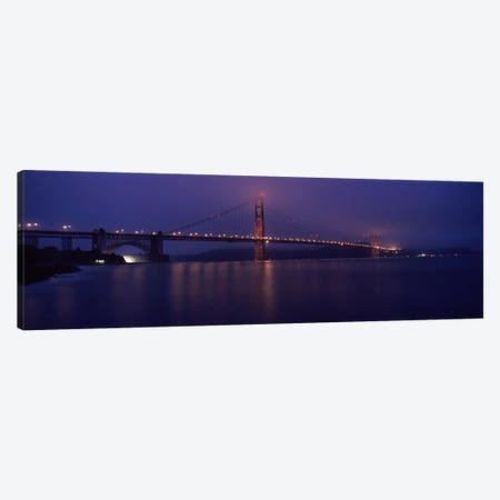 Suspension bridge lit up at dawn viewed from fishing pier, Golden Gate Bridge, San Francisco Bay, San Francisco, California, USA Canvas Print #PIM8325} by Panoramic Images Canvas Print