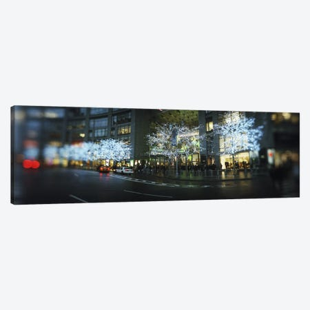 Buildings lit up at the roadsideColumbus Circle, New York City, New York State, USA Canvas Print #PIM8432} by Panoramic Images Canvas Art
