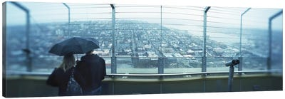 Couple viewing a city from the Space Needle, Queen Anne Hill, Seattle, Washington State, USA Canvas Print #PIM8436