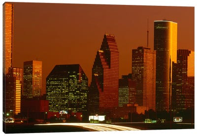 Skyscrapers in a city at sunset, Houston, Texas, USA Canvas Art Print