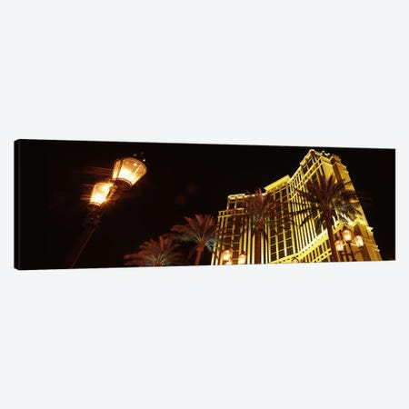 Low angle view of a hotel lit up at night, The Strip, Las Vegas, Nevada, USA Canvas Print #PIM8553} by Panoramic Images Canvas Art Print