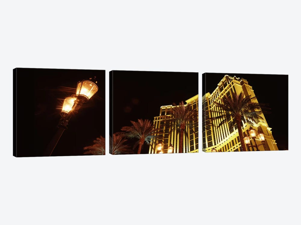 Low angle view of a hotel lit up at night, The Strip, Las Vegas, Nevada, USA by Panoramic Images 3-piece Canvas Print