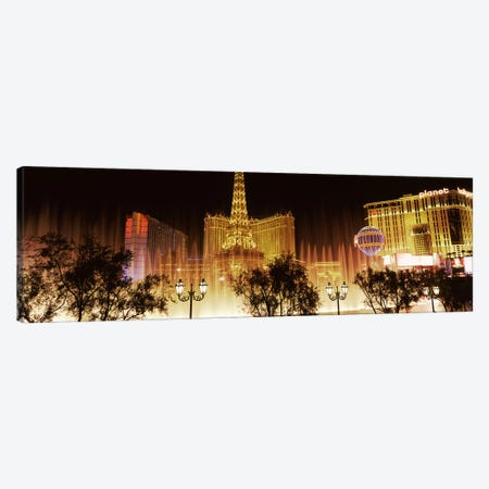 Hotels in a city lit up at night, The Strip, Las Vegas, Nevada, USA Canvas Print #PIM8557} by Panoramic Images Canvas Wall Art