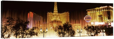 Hotels in a city lit up at night, The Strip, Las Vegas, Nevada, USA Canvas Art Print
