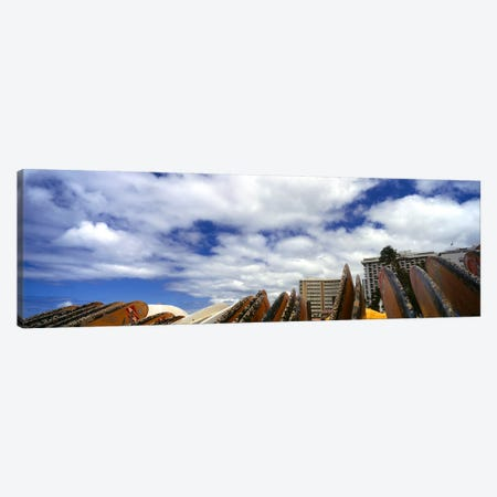 Low angle view of skyscrapers and surfboards, Honolulu, Oahu, Hawaii, USA Canvas Print #PIM8577} by Panoramic Images Canvas Artwork