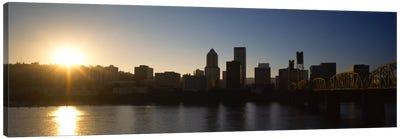 Buildings along the waterfront at sunset, Willamette River, Portland, Oregon, USA Canvas Print #PIM857