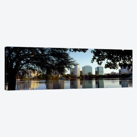 Buildings at the waterfront, Lake Eola, Orlando, Orange County, Florida, USA Canvas Print #PIM8691} by Panoramic Images Canvas Artwork