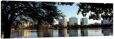 Buildings at the waterfront, Lake Eola, Orlando, Orange County, Florida, USA Canvas Art Print