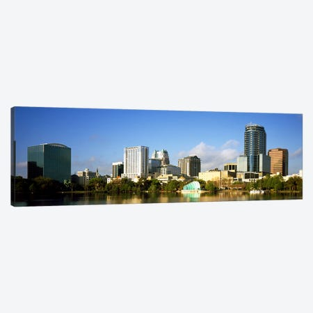 Buildings at the waterfront, Lake Eola, Orlando, Orange County, Florida, USA 2010 Canvas Print #PIM8695} by Panoramic Images Art Print