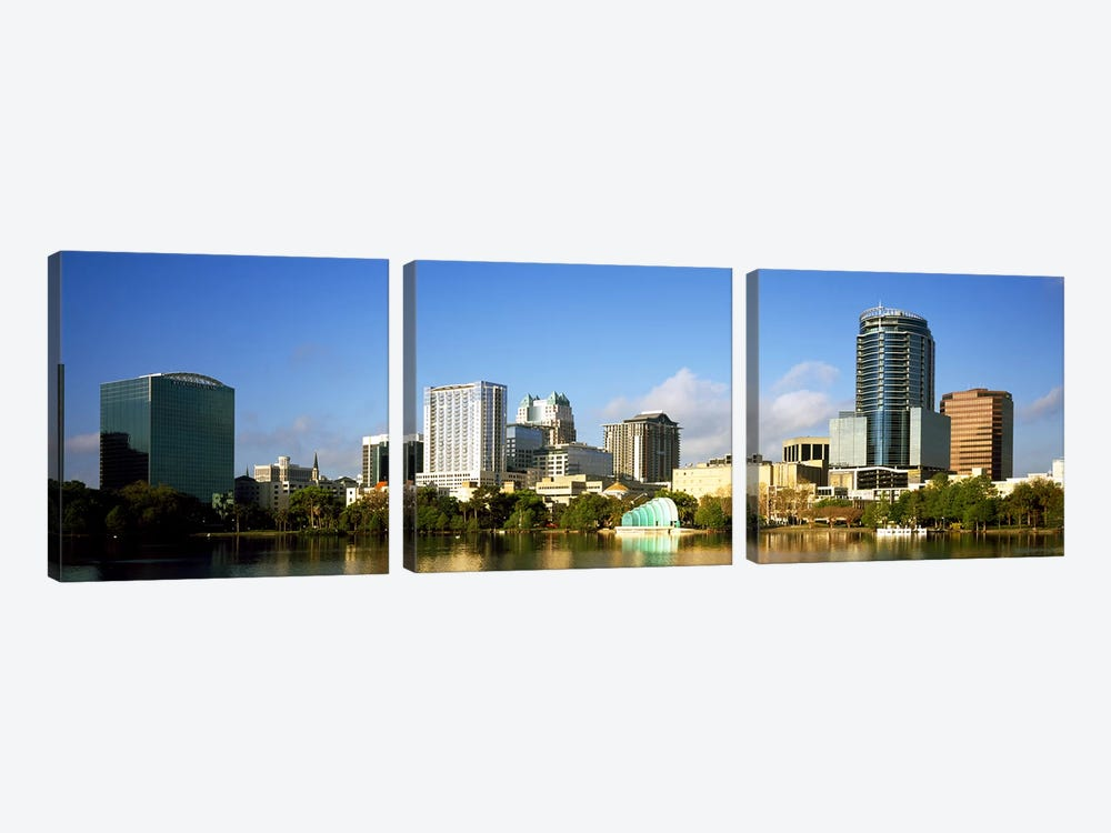 Buildings at the waterfront, Lake Eola, Orlando, Orange County, Florida, USA 2010 by Panoramic Images 3-piece Canvas Print