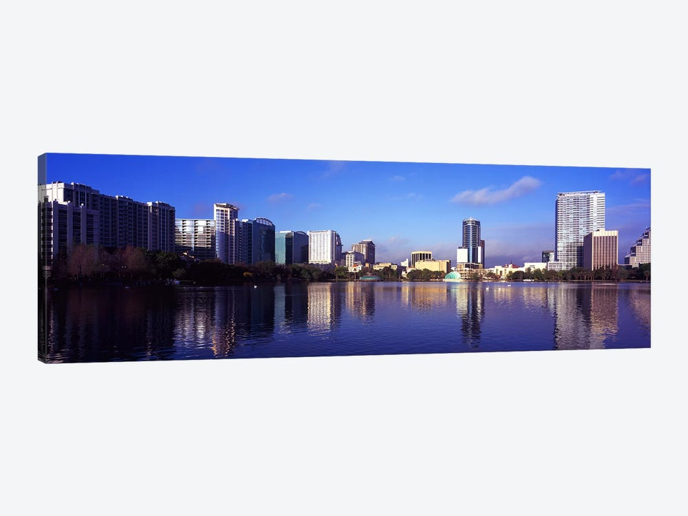 Buildings at the waterfront, Lake Eola, Orlando, Orange County, Florida, USA 2010 #3 by Panoramic Images 1-piece Art Print