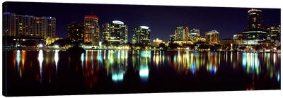 Buildings lit up at night in a city, Lake Eola, Orlando, Orange County, Florida, USA 2010 Canvas Art Print