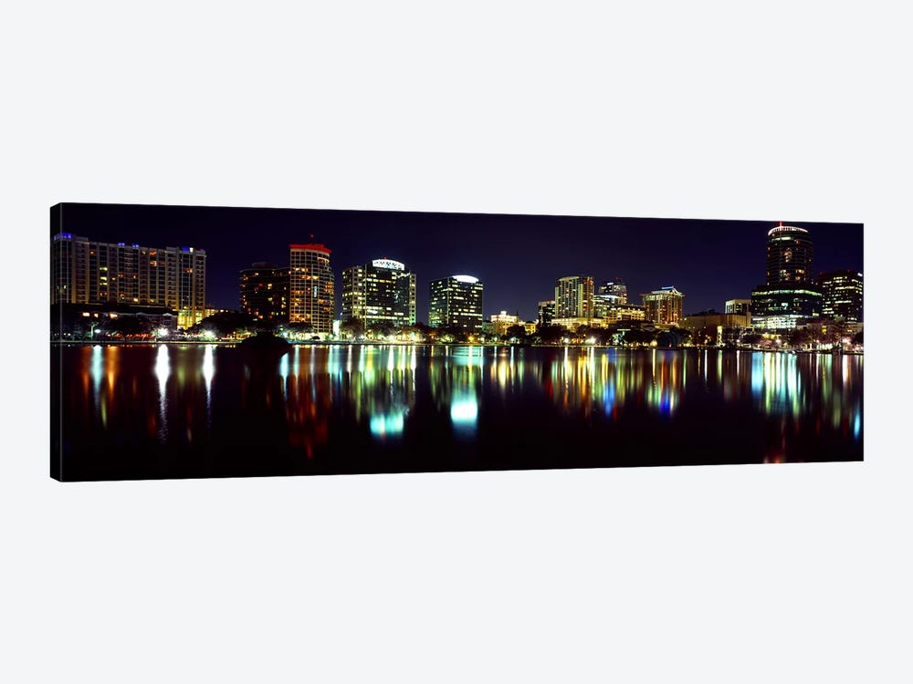 Buildings lit up at night in a city, Lake Eola, Orlando, Orange County, Florida, USA 2010 by Panoramic Images 1-piece Canvas Art Print