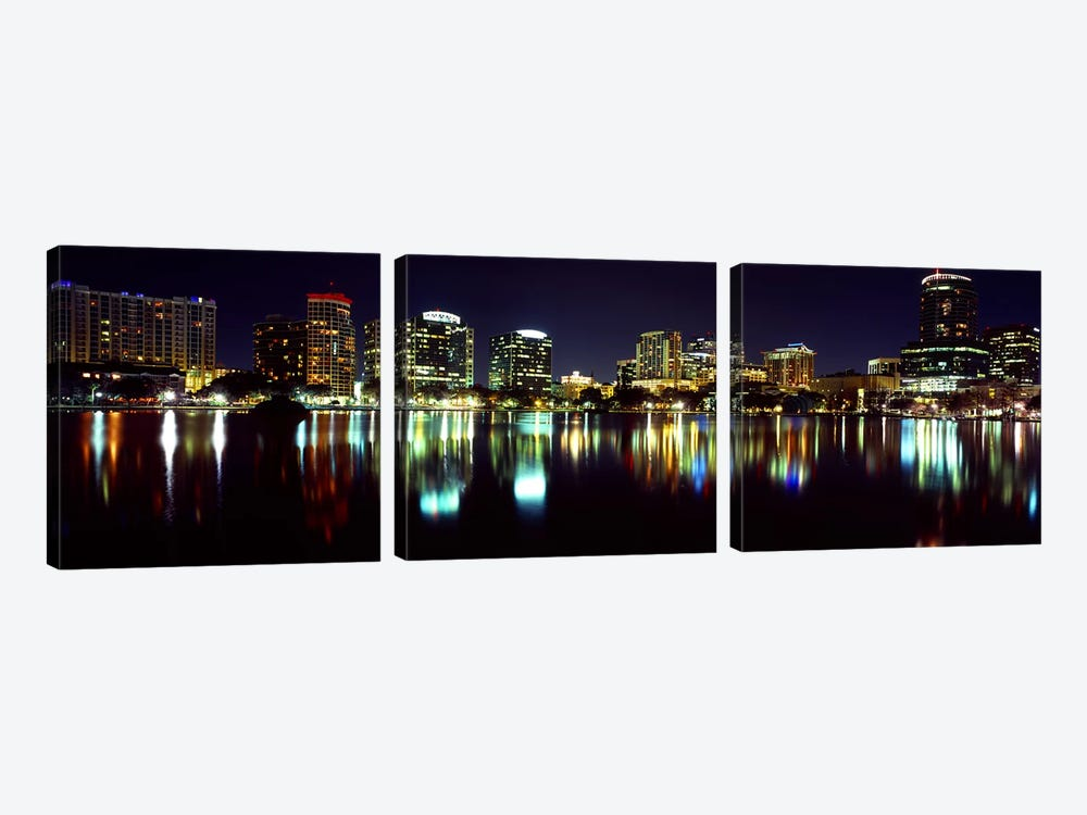 Buildings lit up at night in a city, Lake Eola, Orlando, Orange County, Florida, USA 2010 by Panoramic Images 3-piece Art Print