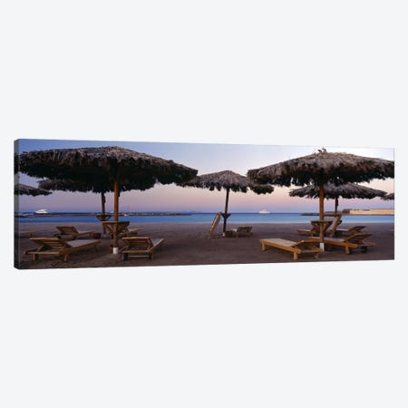 Lounge chairs with sunshades on the beach, Hilton Resort, Hurghada, Egypt Canvas Print #PIM8741} by Panoramic Images Canvas Artwork