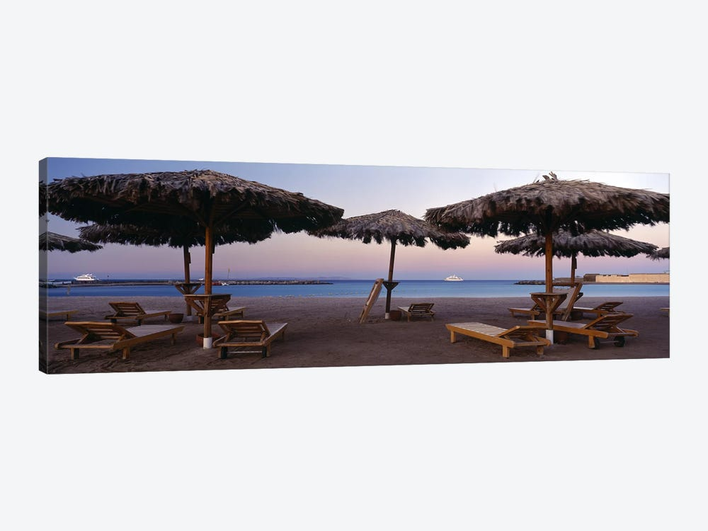 Lounge chairs with sunshades on the beach, Hilton Resort, Hurghada, Egypt by Panoramic Images 1-piece Art Print