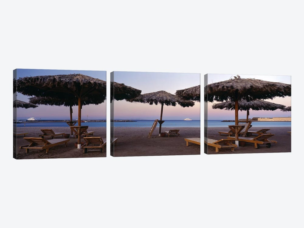 Lounge chairs with sunshades on the beach, Hilton Resort, Hurghada, Egypt by Panoramic Images 3-piece Art Print