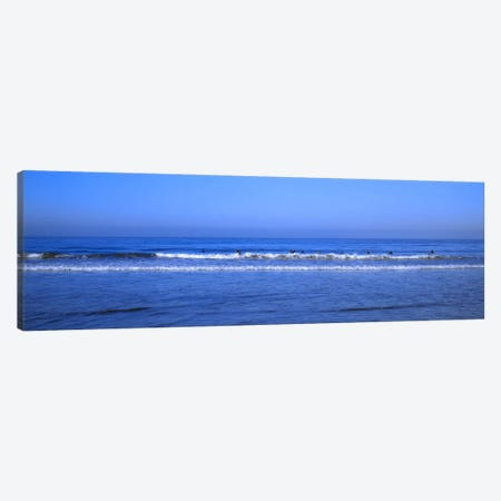 Surfers riding a wave in the sea, Santa Monica, Los Angeles County, California, USA Canvas Print #PIM8759} by Panoramic Images Canvas Print