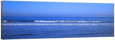 Surfers riding a wave in the sea, Santa Monica, Los Angeles County, California, USA Canvas Art Print