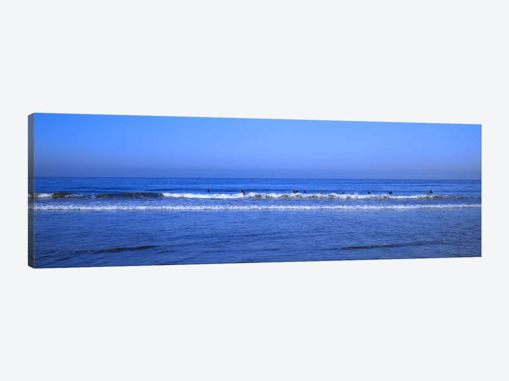 Surfers riding a wave in the sea, Santa Monica, Los Angeles County, California, USA by Panoramic Images 1-piece Canvas Art