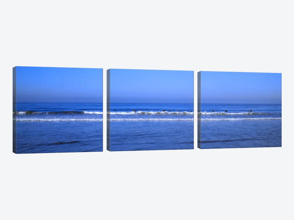 Surfers riding a wave in the sea, Santa Monica, Los Angeles County, California, USA by Panoramic Images 3-piece Canvas Artwork