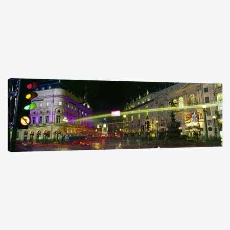 Blurred Motion View Of Nighttime Lights, Piccadilly Circus, London, England Canvas Print #PIM8767} by Panoramic Images Art Print
