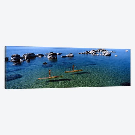 Two women paddle boarding in a lake, Lake Tahoe, California, USA Canvas Print #PIM8846} by Panoramic Images Canvas Art