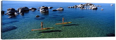 Two women paddle boarding in a lake, Lake Tahoe, California, USA Canvas Art Print