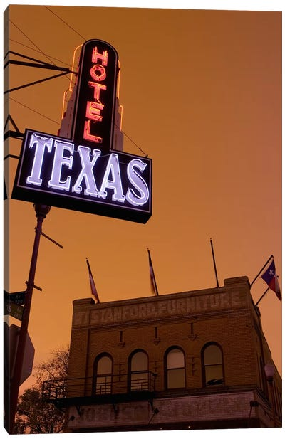 Low angle view of a neon sign of a hotel lit up at dusk, Fort Worth Stockyards, Fort Worth, Texas, USA Canvas Print #PIM8859