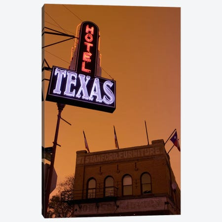 Low angle view of a neon sign of a hotel lit up at dusk, Fort Worth Stockyards, Fort Worth, Texas, USA Canvas Print #PIM8859} by Panoramic Images Canvas Wall Art