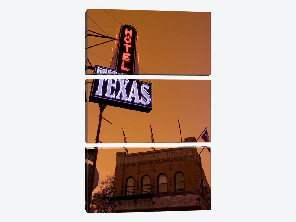 Low angle view of a neon sign of a hotel lit up at dusk, Fort Worth Stockyards, Fort Worth, Texas, USA by Panoramic Images 3-piece Canvas Artwork